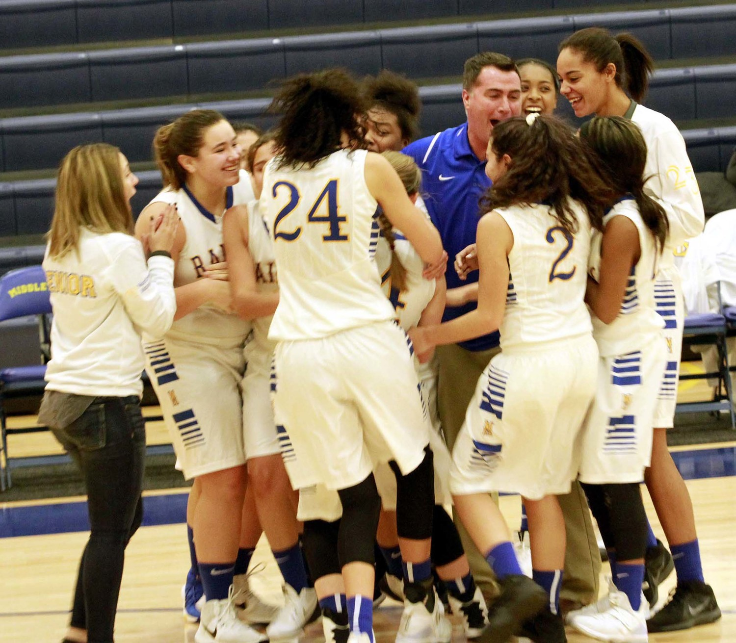 Coach Ron Stetler and the Blue Raiders celebrate their last-second win vs. Steel-High on Monday night.