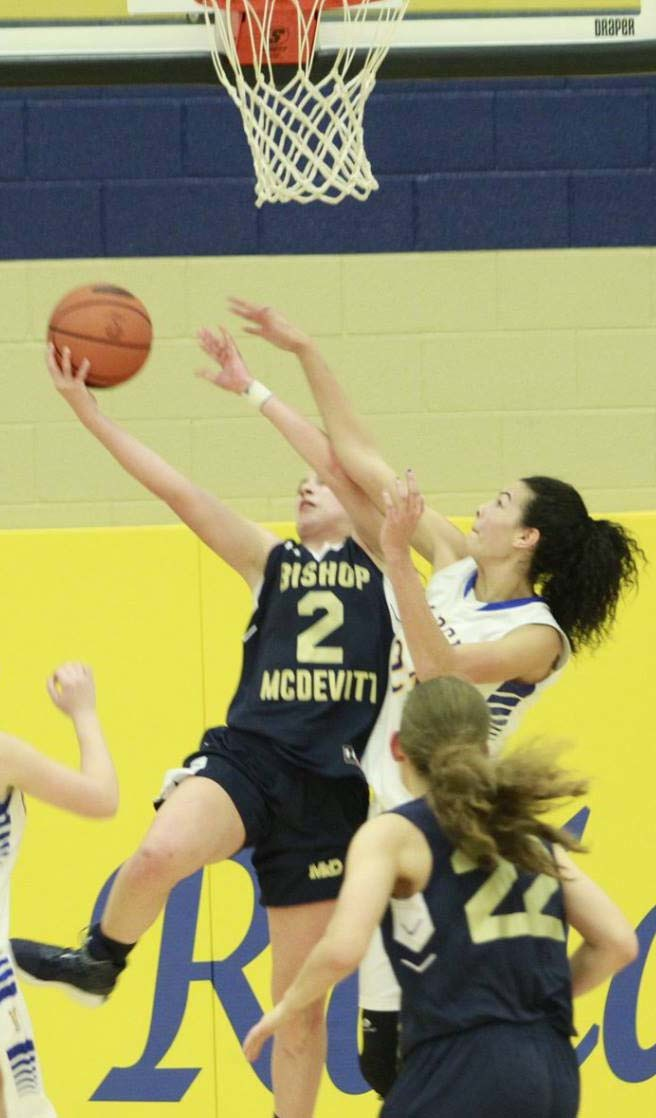 Jae Keller tries to block a shot Saturday in Middletown's 47-38 home loss to Bishop McDevitt.