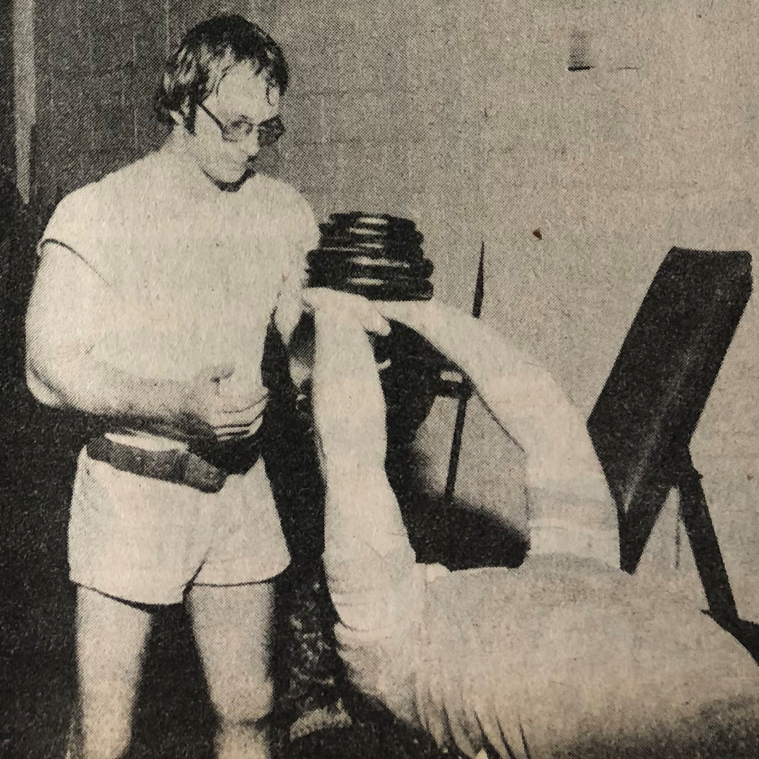 Don Smith spots Steve Markus doing dumbbell pullovers.