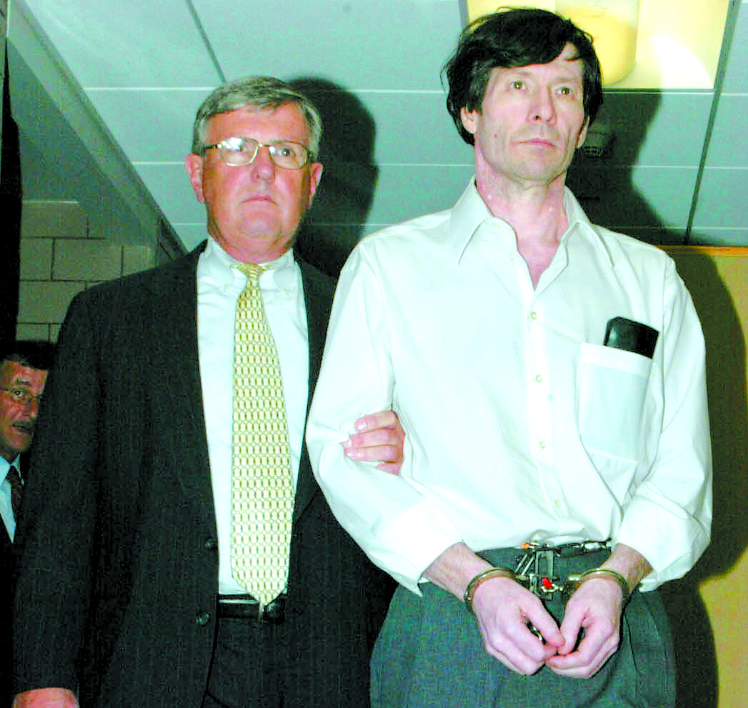 Ernest Wholaver is escorted by Dauphin County Sheriff Jack Lotwick, Tuesday, Aug. 31, 2004, after being sentence to death for the murder of his daughters and wife on Christmas Eve Day in 2002.