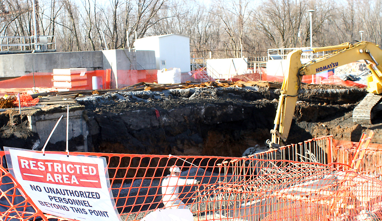 Workers remove soil contaminated with arsenic from the Highspire Waste Water Treatment Plant site. Workers must wear special disposable Tyvek suits when working with the soil.