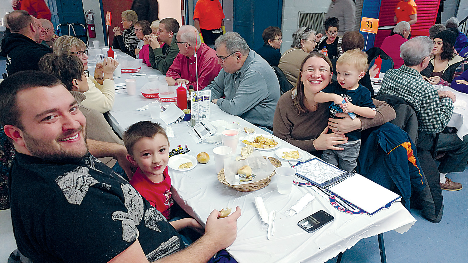 The Crone family pauses from dinner at the Seven Sorrows fish fry in 2017 Left to right are Shane, Leo, Nadine and Bennet Crone.