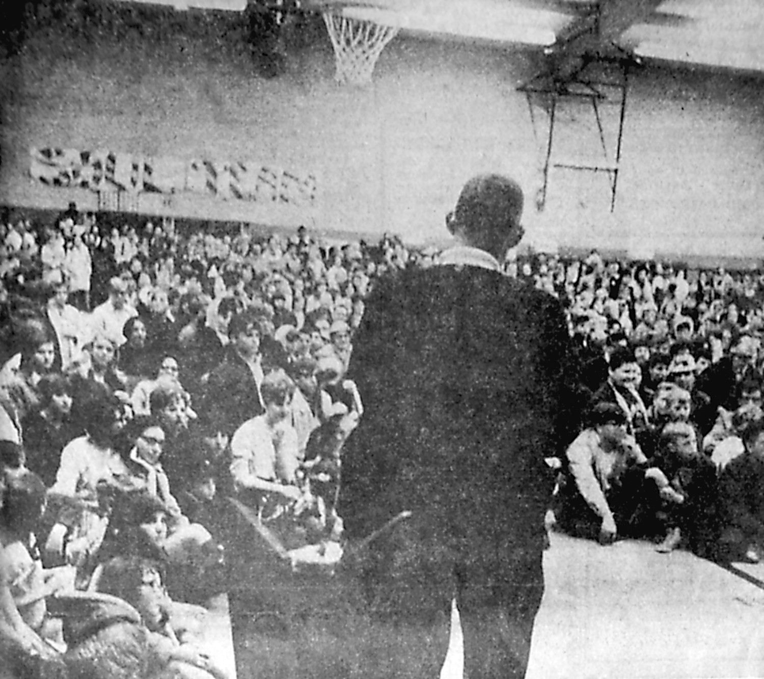 A real welcome home was extended Saturday afternoon, March 23, 1968, to the Middletown Blue Raiders, who won the PIAA Class B State Championship in a final game with East Brady at Pittsburgh the night before. Local folks literally by the thousands turned out to greet the team. The high point, following a parade about town, was in the gym where Principal Edward Brunner, shown with back to camera, introduced the personnel to a record crowd.