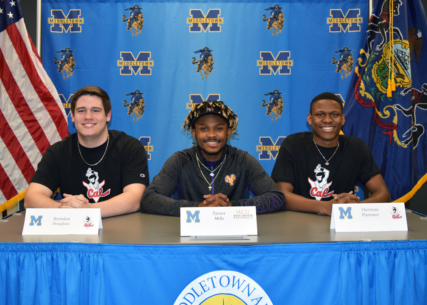 Middletown's Brendan Douglass, Tyreer Mills and Chris Plummer plan to continue their football careers in college.