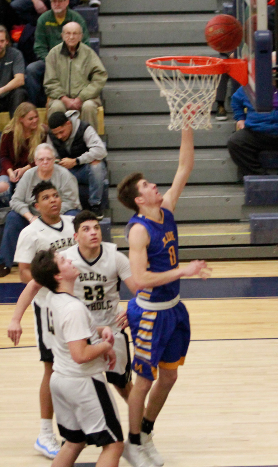 Ryan Hughes drives to the basket vs. Berks Catholic.