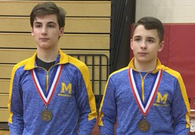 Ryan Berstler and Luke Fegley wear their regional medals after competition this weekend at Wilson High School.