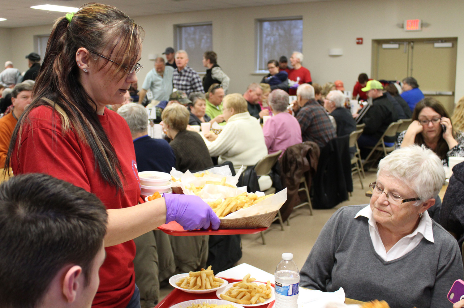 Michelle Goho serves Beverly Villers during Londonderry Fire Company's fish fry March 2.