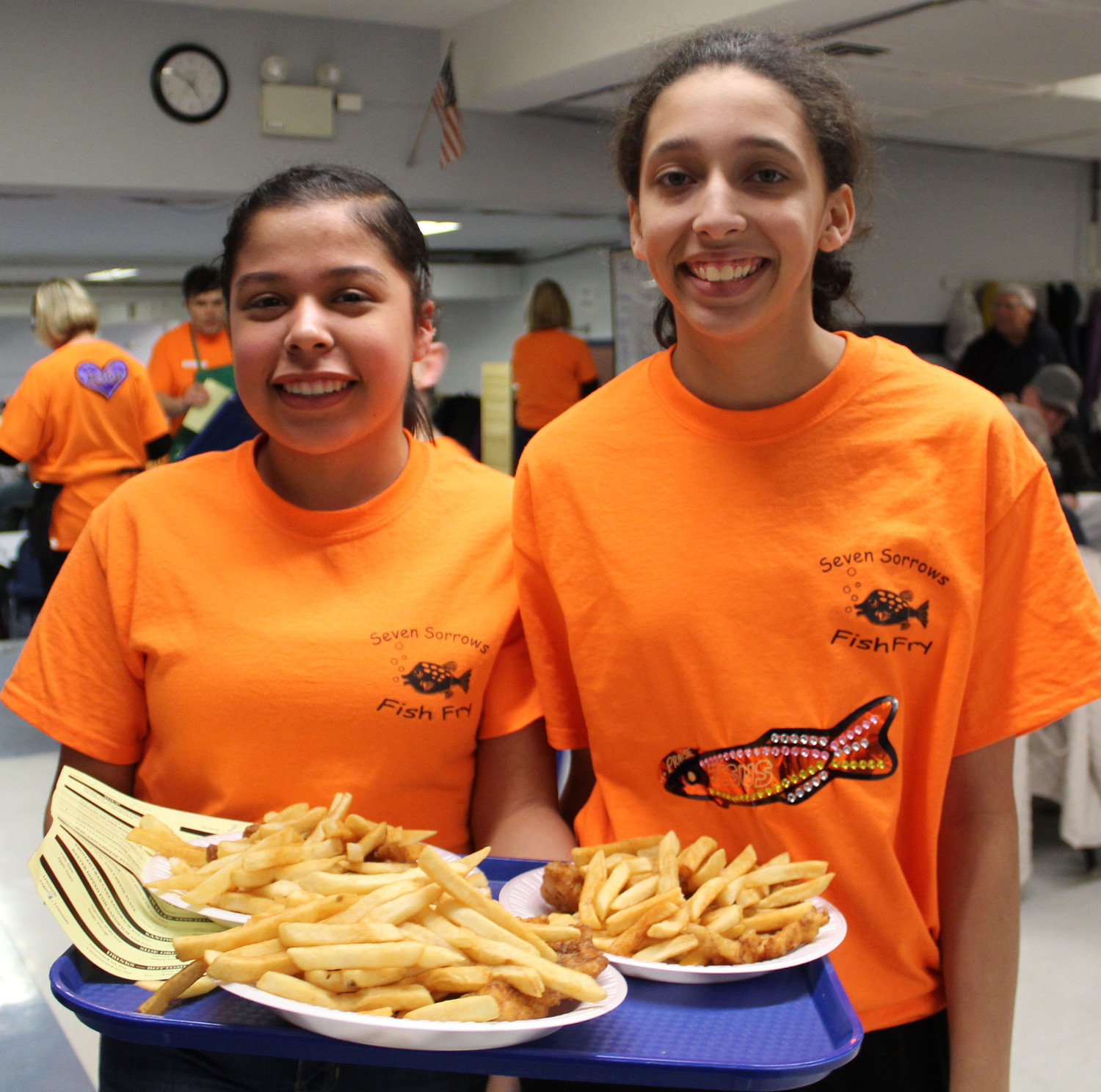 Volunteers like Veronica Martin and Erin Hess-Moore were busy running orders during Seven Sorrows' fish fry March 2.
