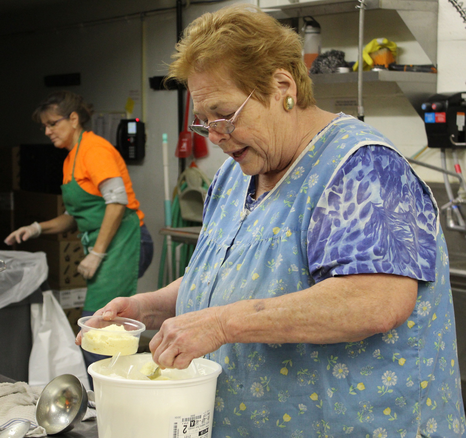Joyce Corradi was one of many volunteers helping out in Seven Sorrows' kitchen March 2.