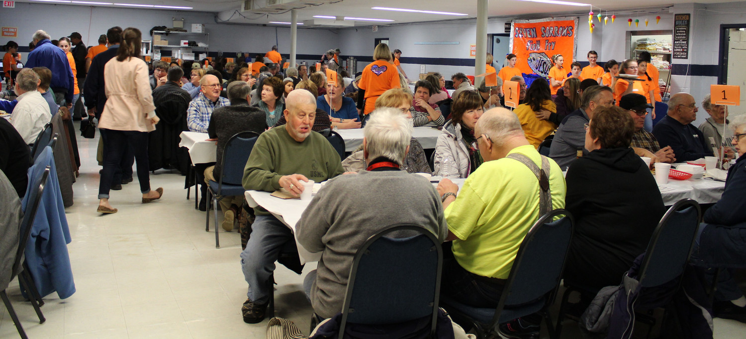Volunteers were busy on March 2 serving people during Seven Sorrows' fish fry.