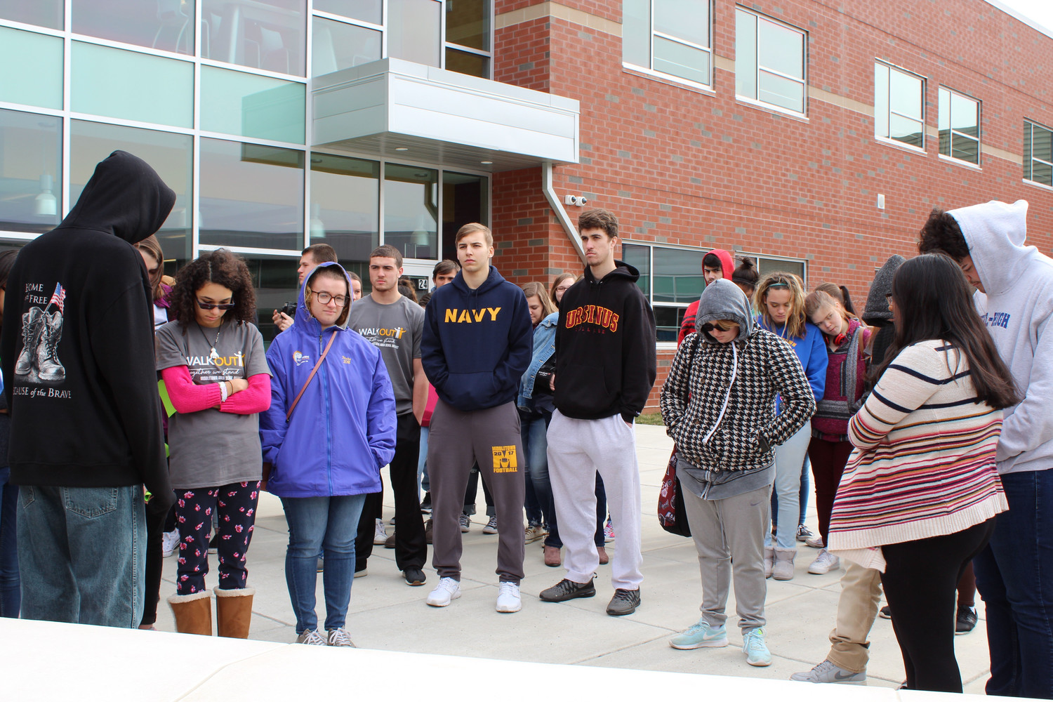 Seventy-eight students participated in the walkout, including Kyle Truesdale and Ryan Hughes, both in sweatpants. Organizers said the students came from a variety of student clubs and sports teams. Truesdale and Hughes play on the basketball team.