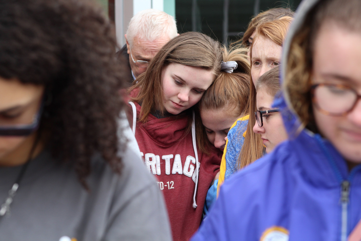 Junior Alexis Harmon and Abrielle Spagnolo comfort each other during the moment of silence.