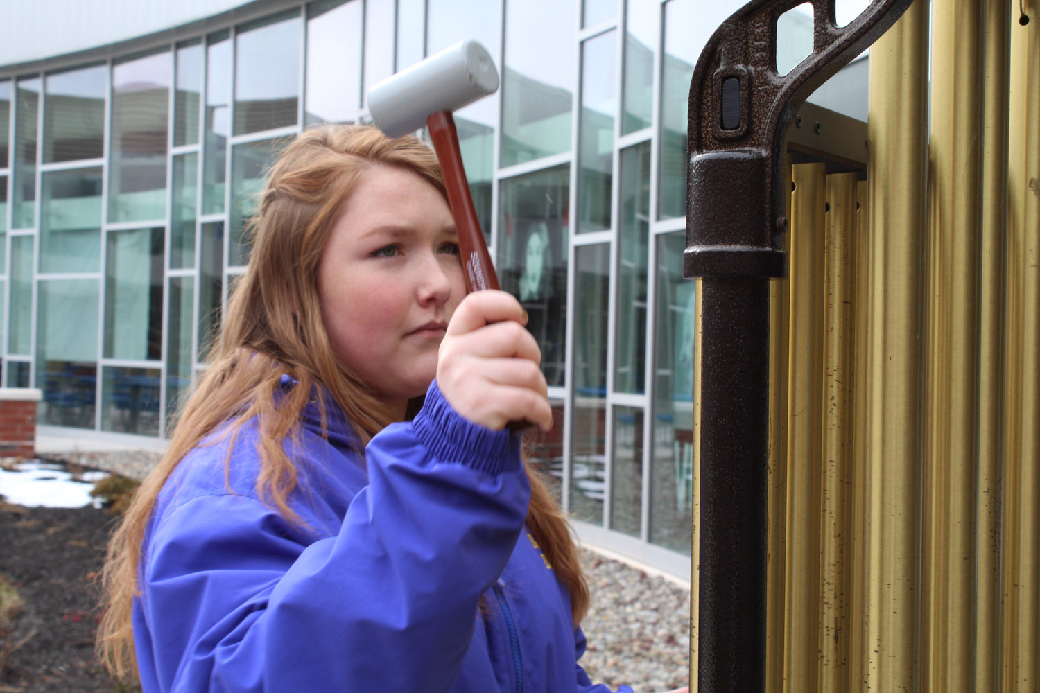 Zoey Bright rang the chimes 17 times in honor of the 17 people who died in Florida.