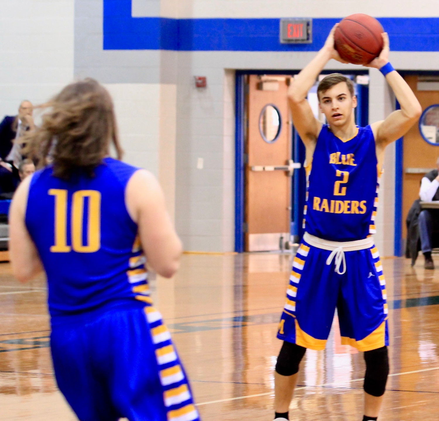 Kyle Truesdale looks toward Brady Fox to pass the ball during Middletown's 47-45 win vs. Overbrook in the second round of the 4A state playoffs Tuesday night at Garden Spot High School.