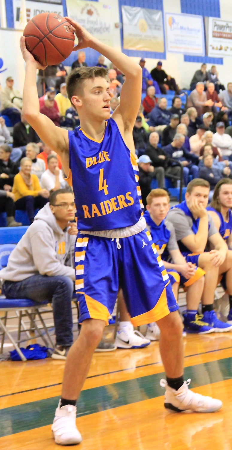 Tyler Petroski looks for someone to pass the ball to during Middletown's 47-45 win vs. Overbrook in the second round of the 4A state playoffs Tuesday night at Garden Spot High School.