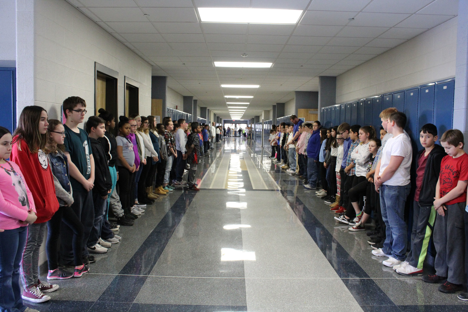 MAMS students stood shoulder-to-shoulder in silence as 17 chimes played over the intercom in memory of the people who died in Parkland, Fla.
