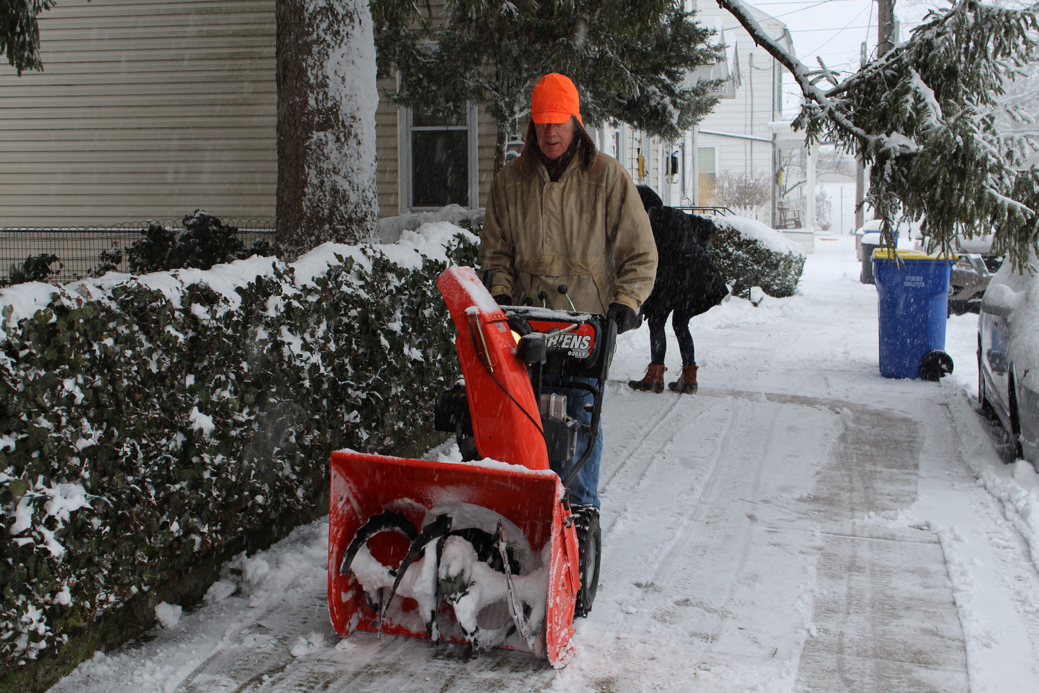 Charlie Bowen clears the snow in front of his house after the snowfall.