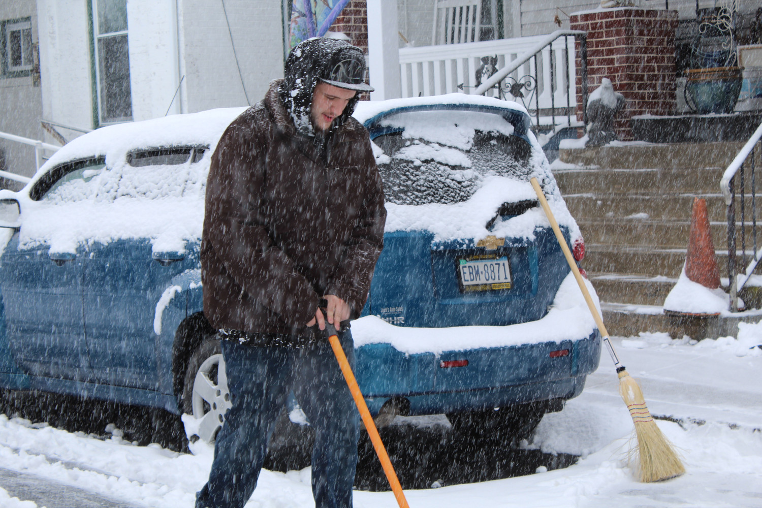Residents like Tyler Bangert braved the snow Wednesday morning.