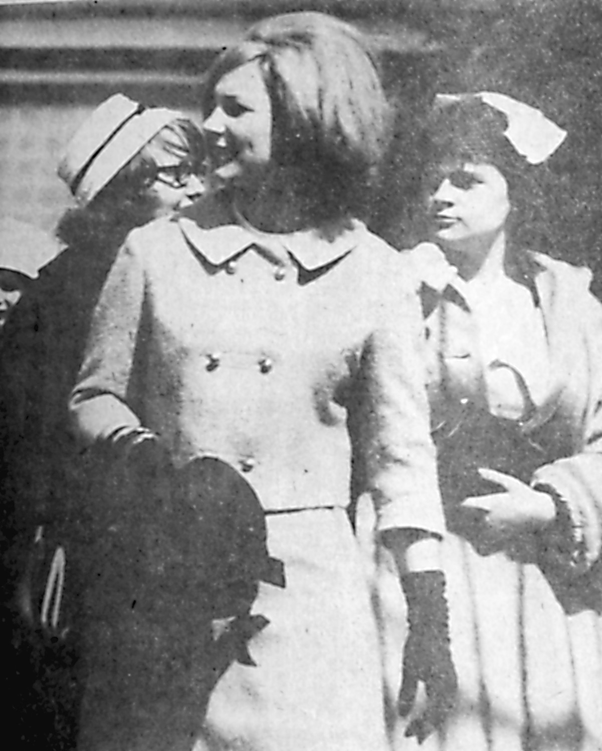 The Easter parade began just after church Sunday. It was windy and chilly but a sunny day. The young lady, Miss Sandra Gofhus, looks chic in her new suit and carries the new bonnet in hand.