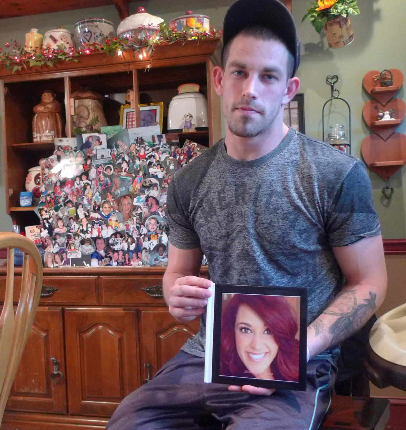 Kyle Cox holds a photo of his fiancee, Elizabeth Loranzo, who died of an accidental overdose from heroin laced with fentanyl on March 19, 2017.