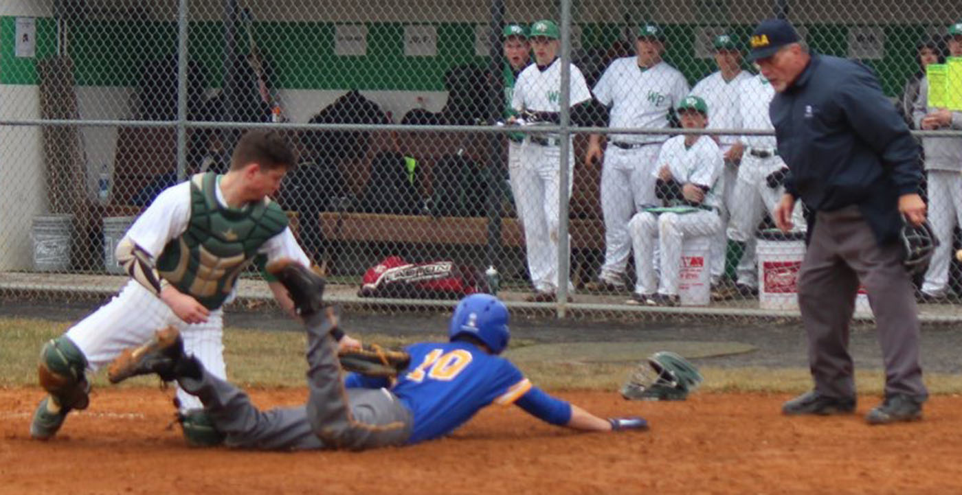 David Alcock beats the throw home for Middletown's second run against West Perry.