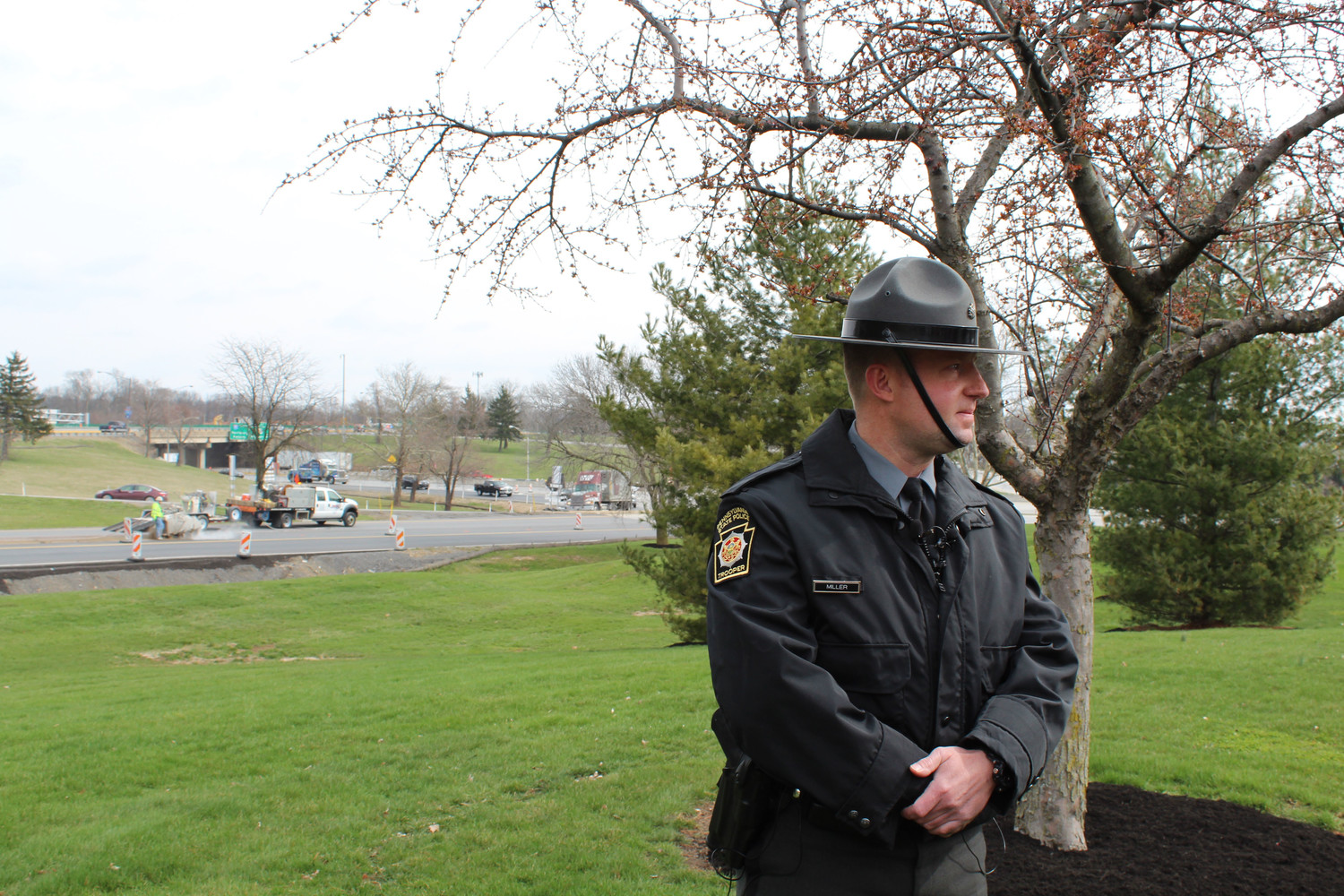 State Trooper Brent Miller stands in front of construction on Route 238 during a press conference on April 6.
