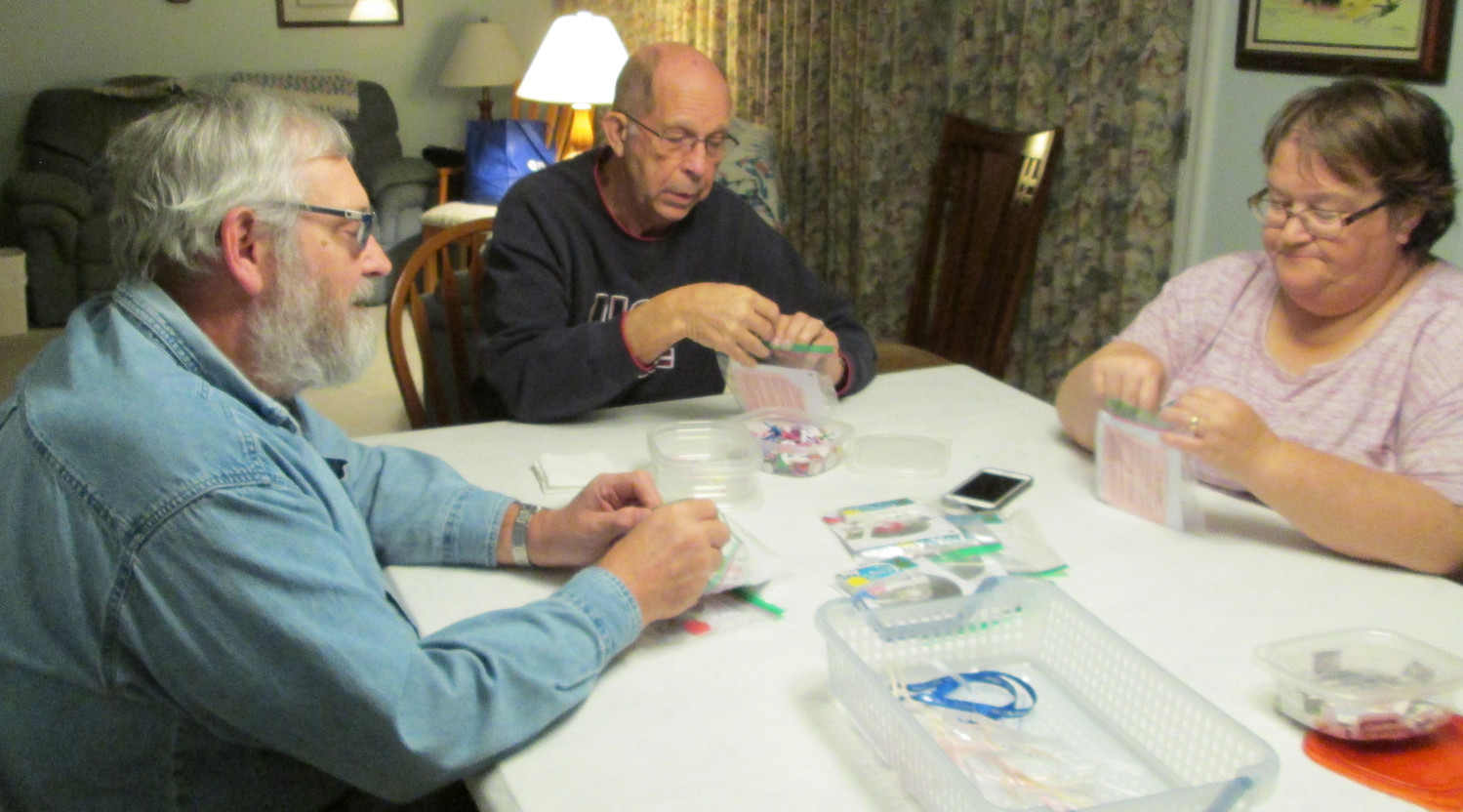 Kiwanians work on packing CD crafts.