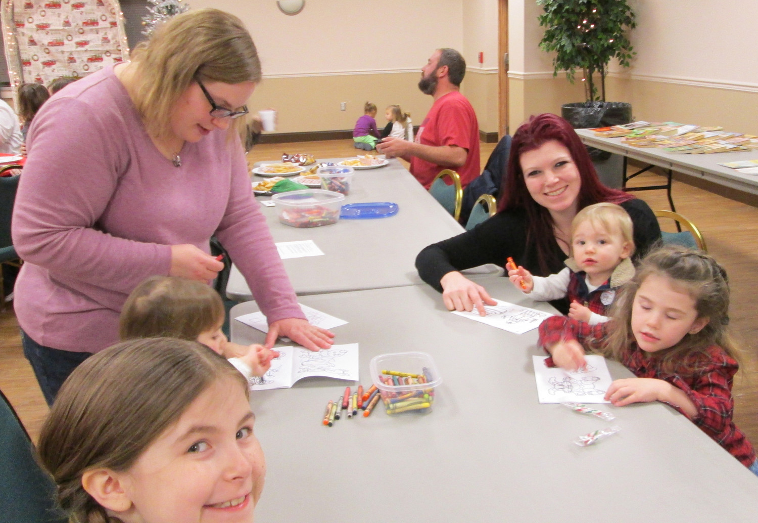 Children enjoy a project at the Chambers Hill Fire Company Santa party on Dec. 16.