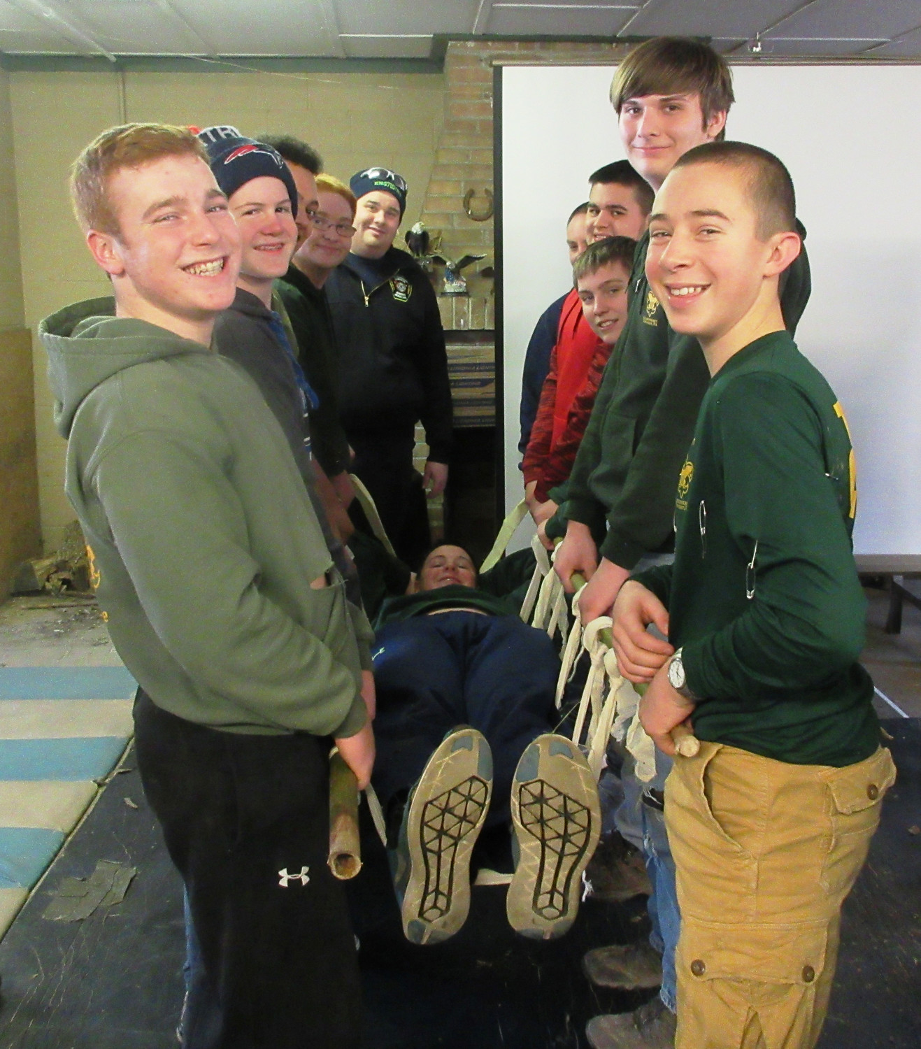 "Members of Troop 97 learned how to use rope lashings and a sleeping bag as a transport system for ""patient"" Ben Spangenberg."