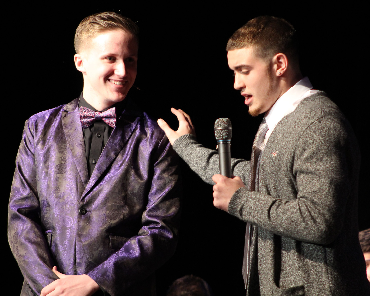 Mr. Middletown winner Tre' Leach, right, answers questions from emcee Gabe Wisniewski during the interview portion of the Mr. Middletown pageant on April 13.