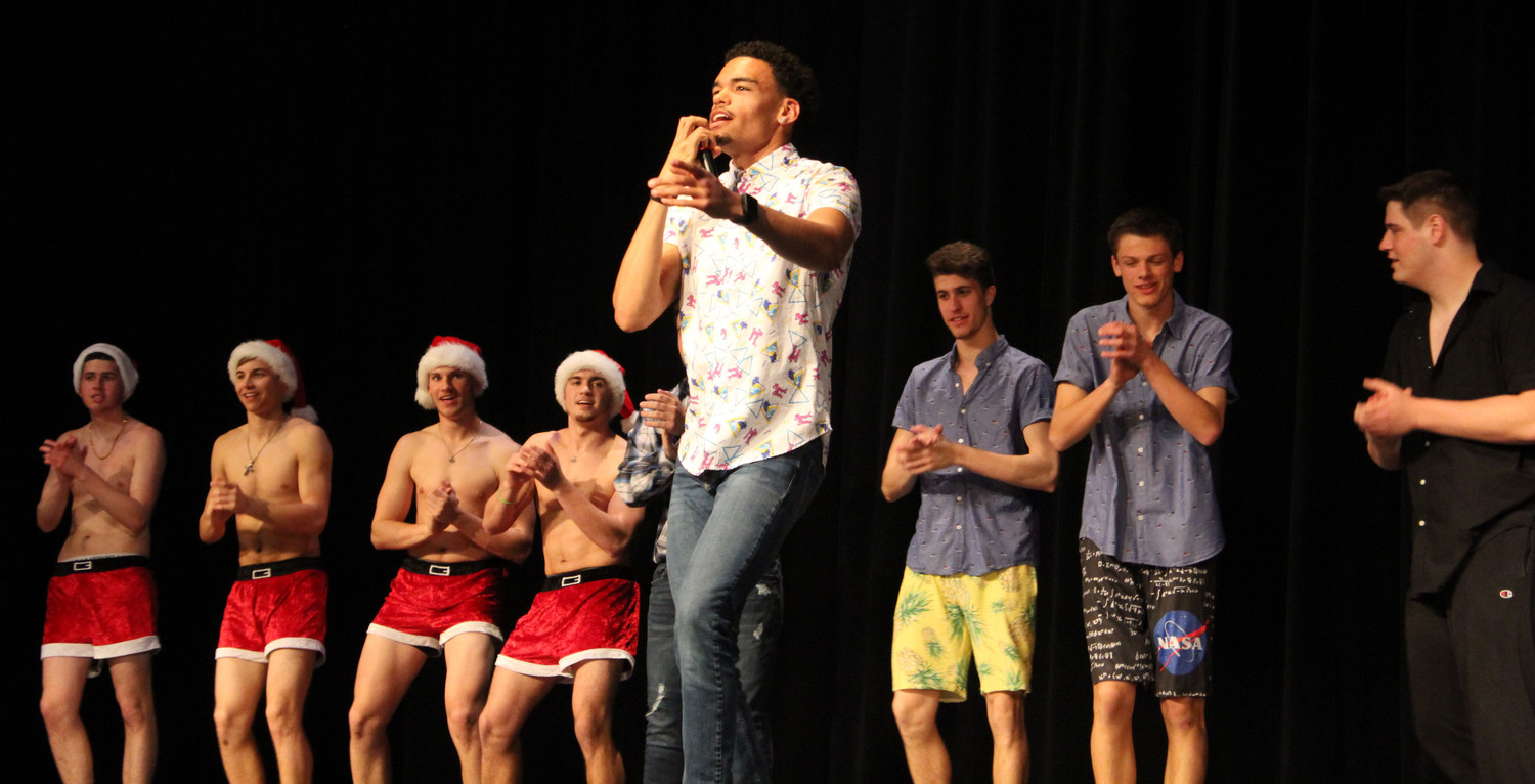 "Matt Frehse lipsyncs to Earth, Wind, and Fire's ""September"" during the Mr. Middletown pageant on April 13."