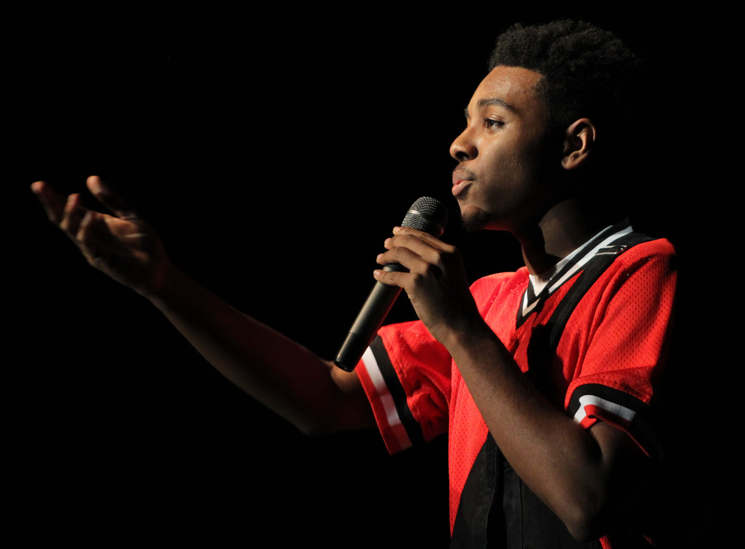 Amir Simmons serenades the crowd during the talent portion of the Mr. Middletown pageant on April 13.