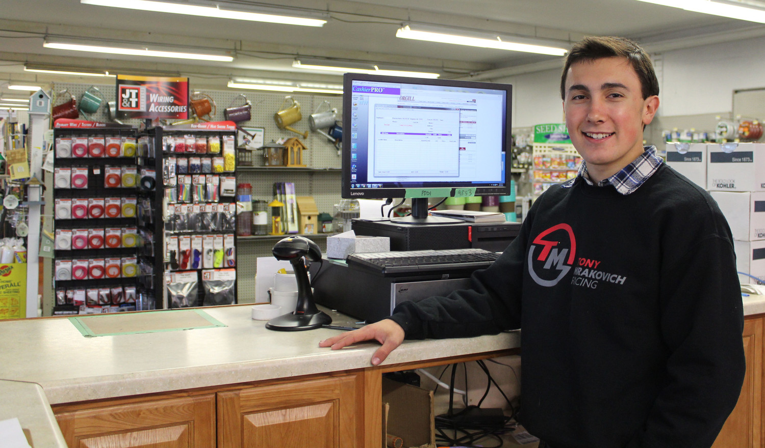 NASCAR racer Tony Mrakovich works behind the counter of his father's store Street Stores Hardware in Middletown.