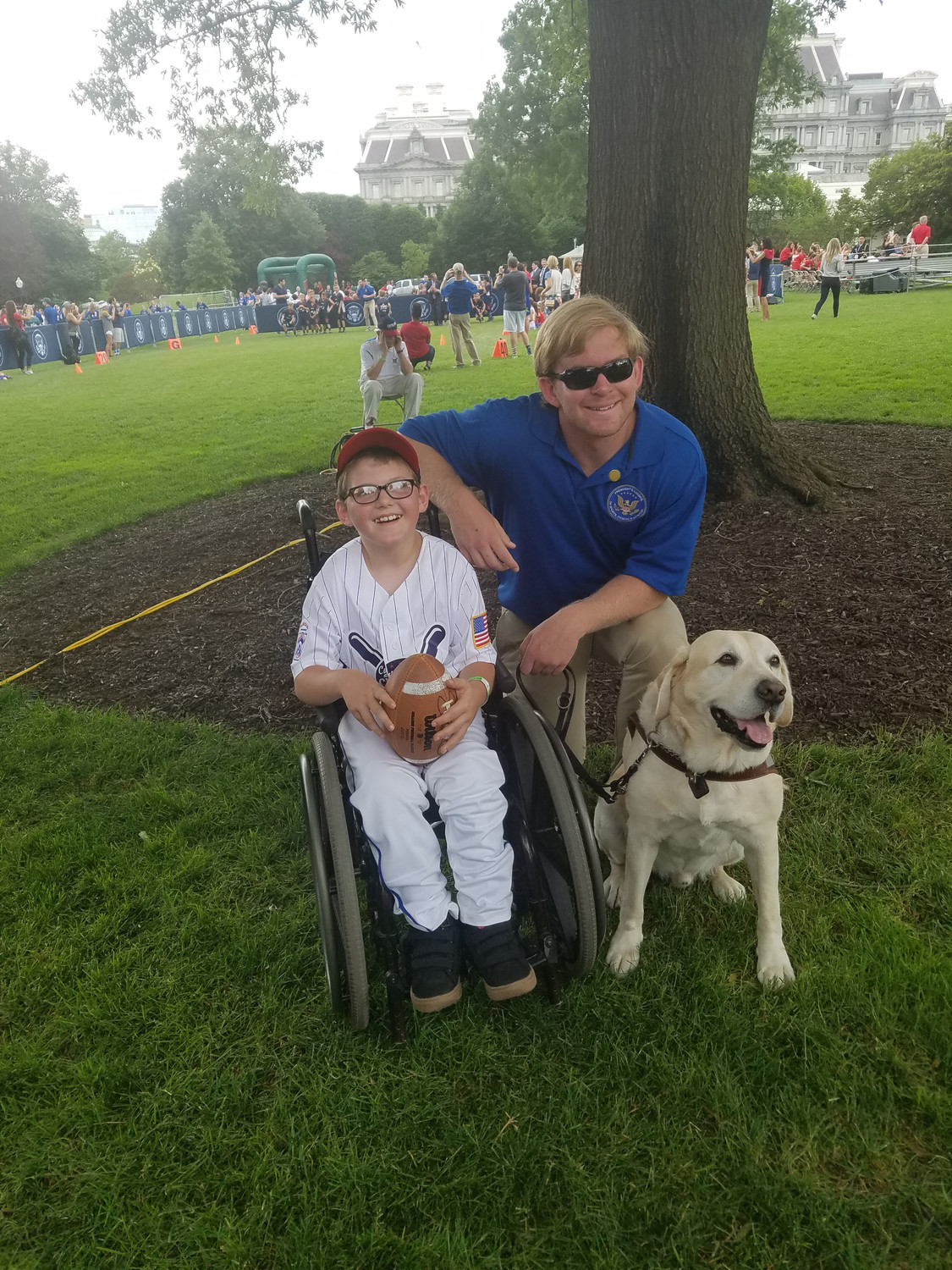 Ethan Whitaker smiles with football player Jake Olson during a White House field day on May 30.