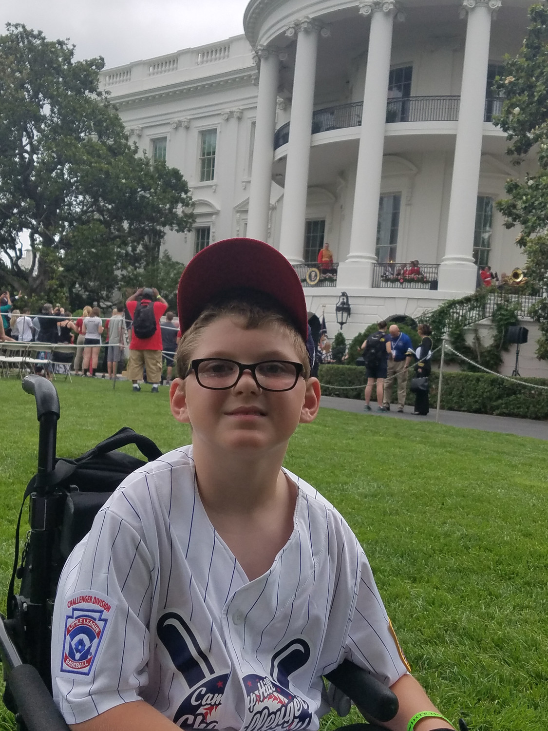 Ethan Whitaker in front of the White House. Ethan was one of the members of the Challenger Baseball League that went to a White House field day on May 30.
