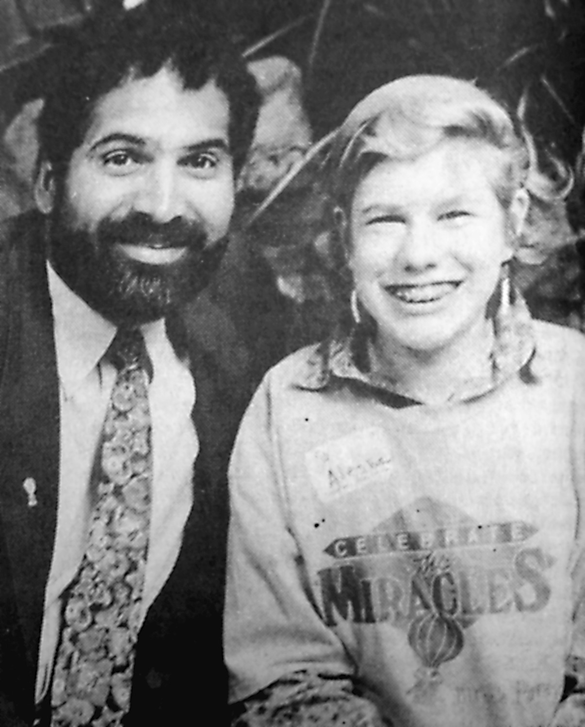 Miracle child Alesha Noll, the daughter of Ronald Thomas and Amanda Noll of Middletown, is pictured with Franco Harris, former Penn State Nittany Lion and Pittsburgh Steeler. Harris was honorary chairman of the 1992 Children's Miracle Network Telethons held May 30 and 31 at Hershey's Chocolate World visitors center. The benefit raised $825,246 to benefit pediatric services at Penn State University Children's Hospital.