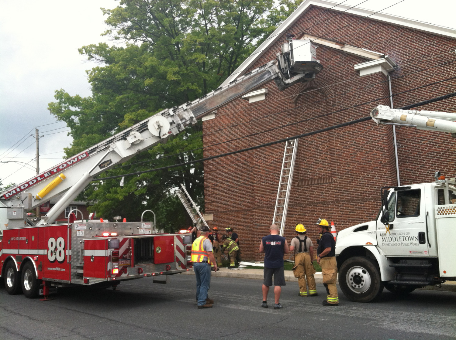 Middletown firefighters investigate an electrical short circuit that caused minor damage to the exterior of the Calvary Orthodox Presbyterian Church at Spruce and East Emaus streets at about 3 p.m. on Thursday, July 5.