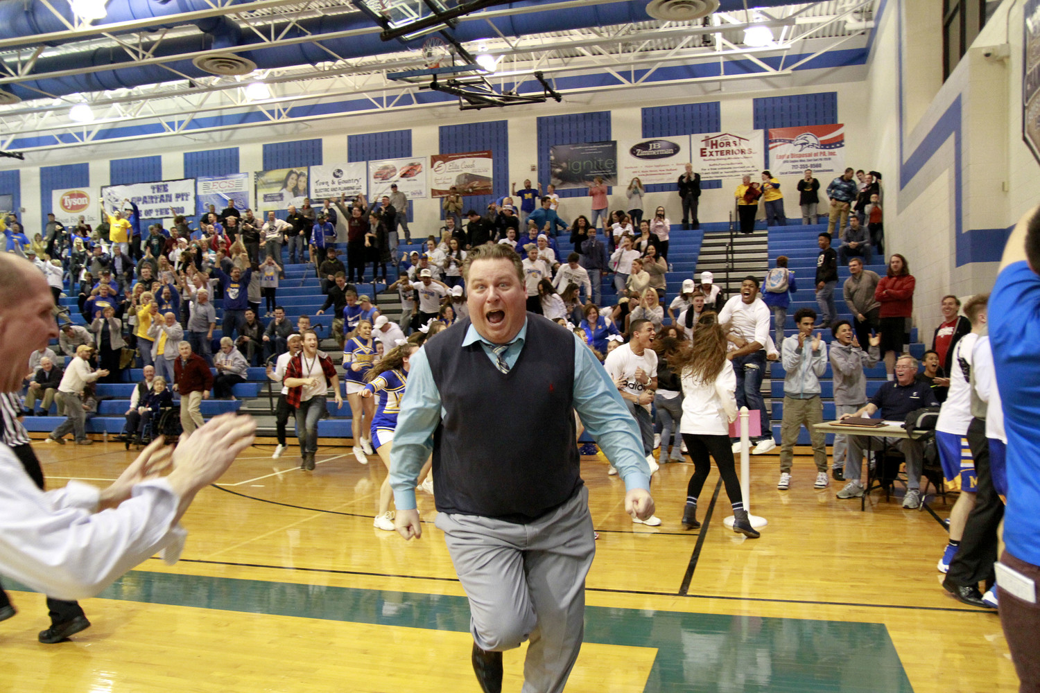 Middletown boys basketball head coach Chris Sattele celebrates after his team won Feb. 27, 2017, on a last-second shot to advance to the district finals.