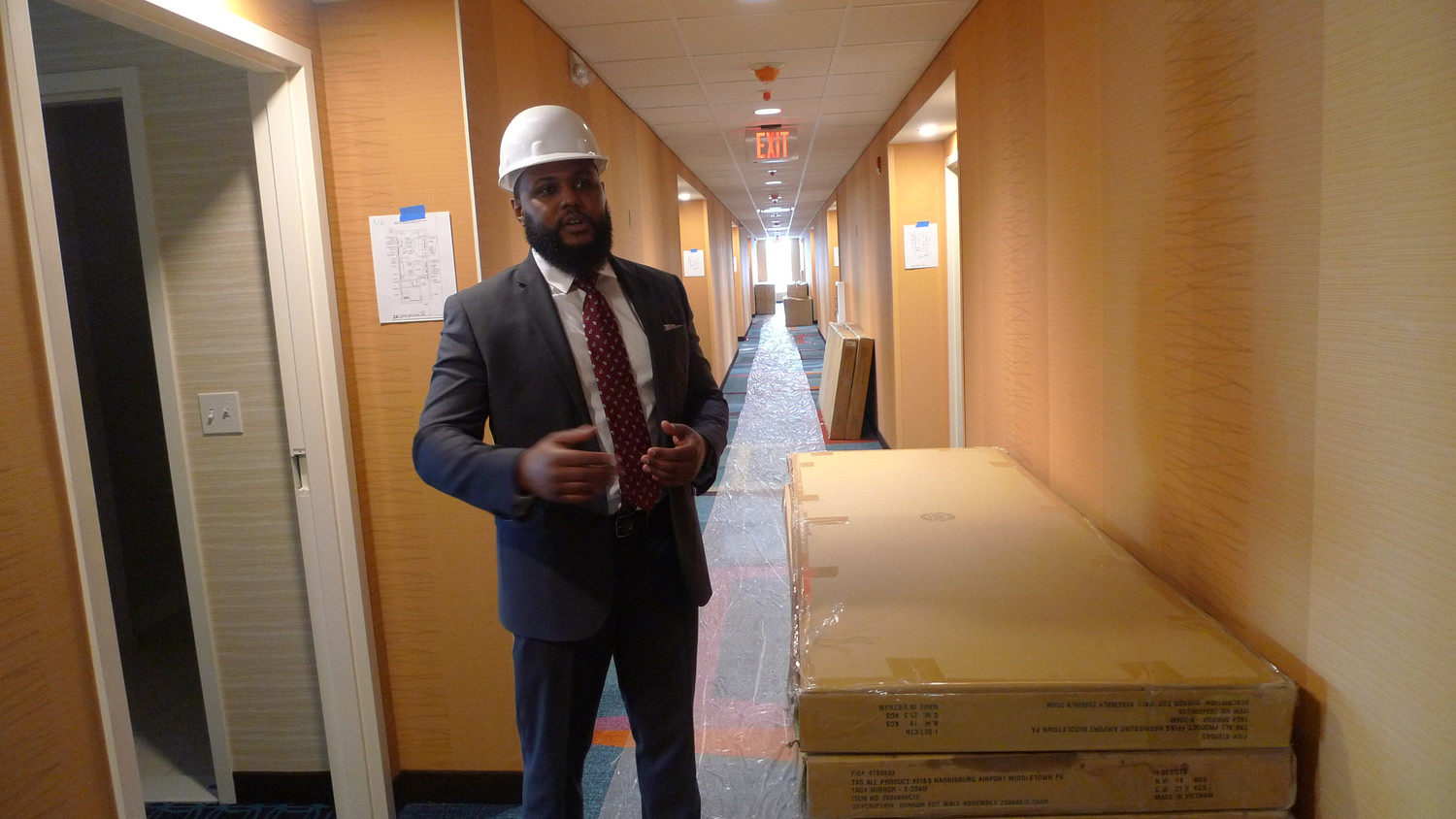 Surrounded in the hallway with beds and other amenities that will be going into the rooms, General Manager Mark Anthony Burnett II talks about the features that will be part of the new Fairfield Inn & Suites that is to open on Harrisburg International Airport around the second week of September.