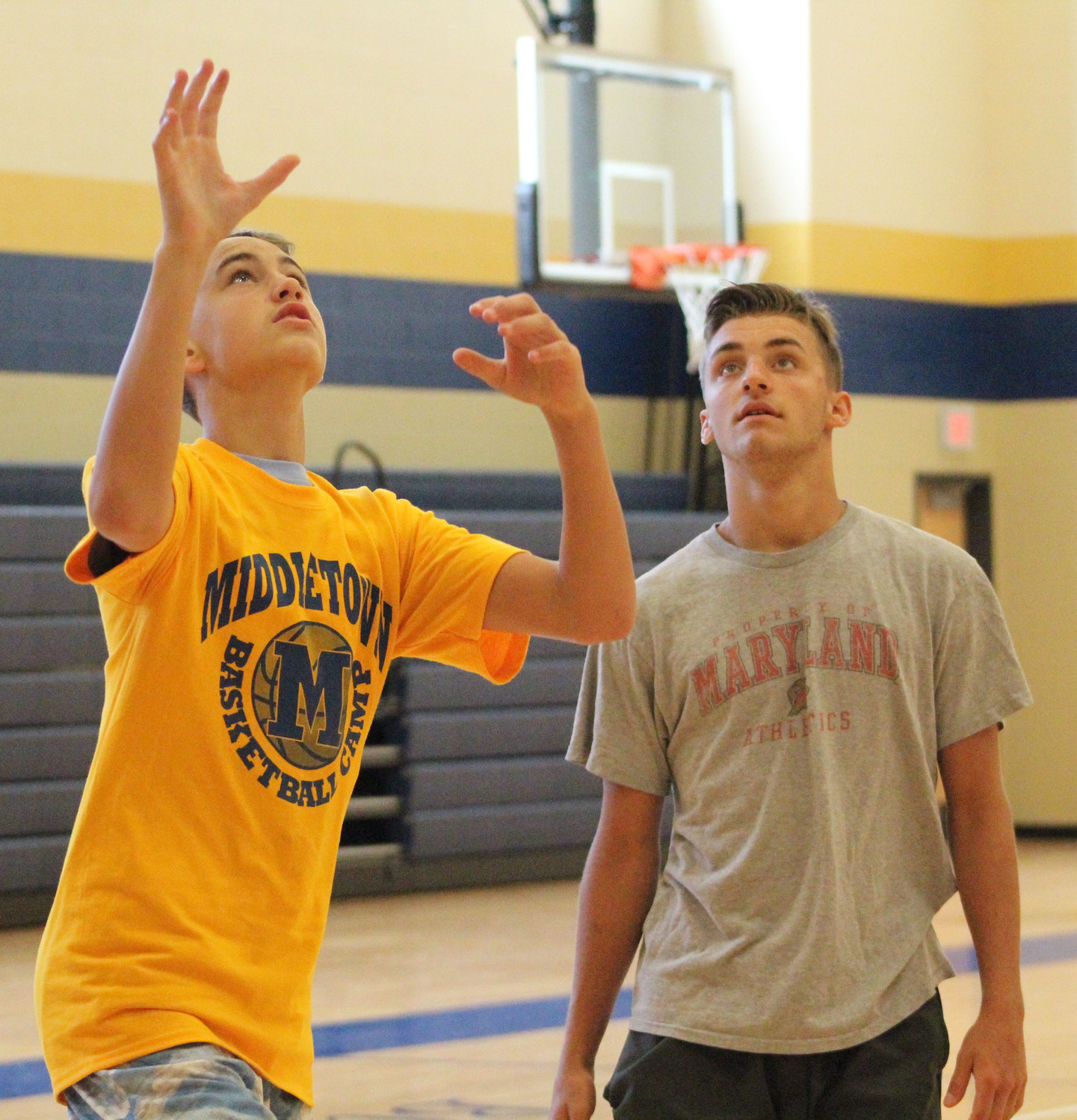 Eli Akins goes for the rebound during basketball camp on July 12.