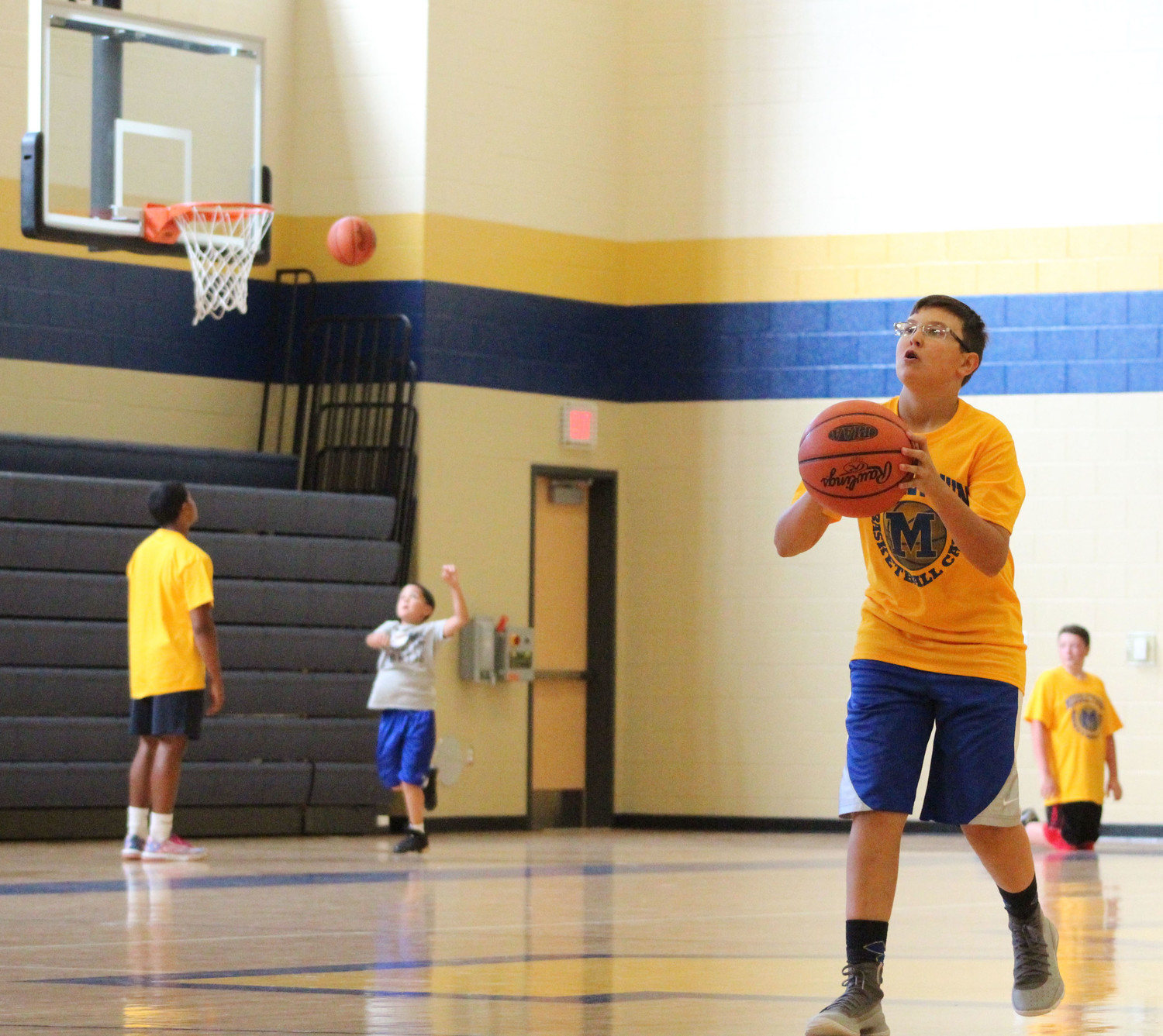 RJ Romboc shoots a three pointer during basketball camp on July 12.