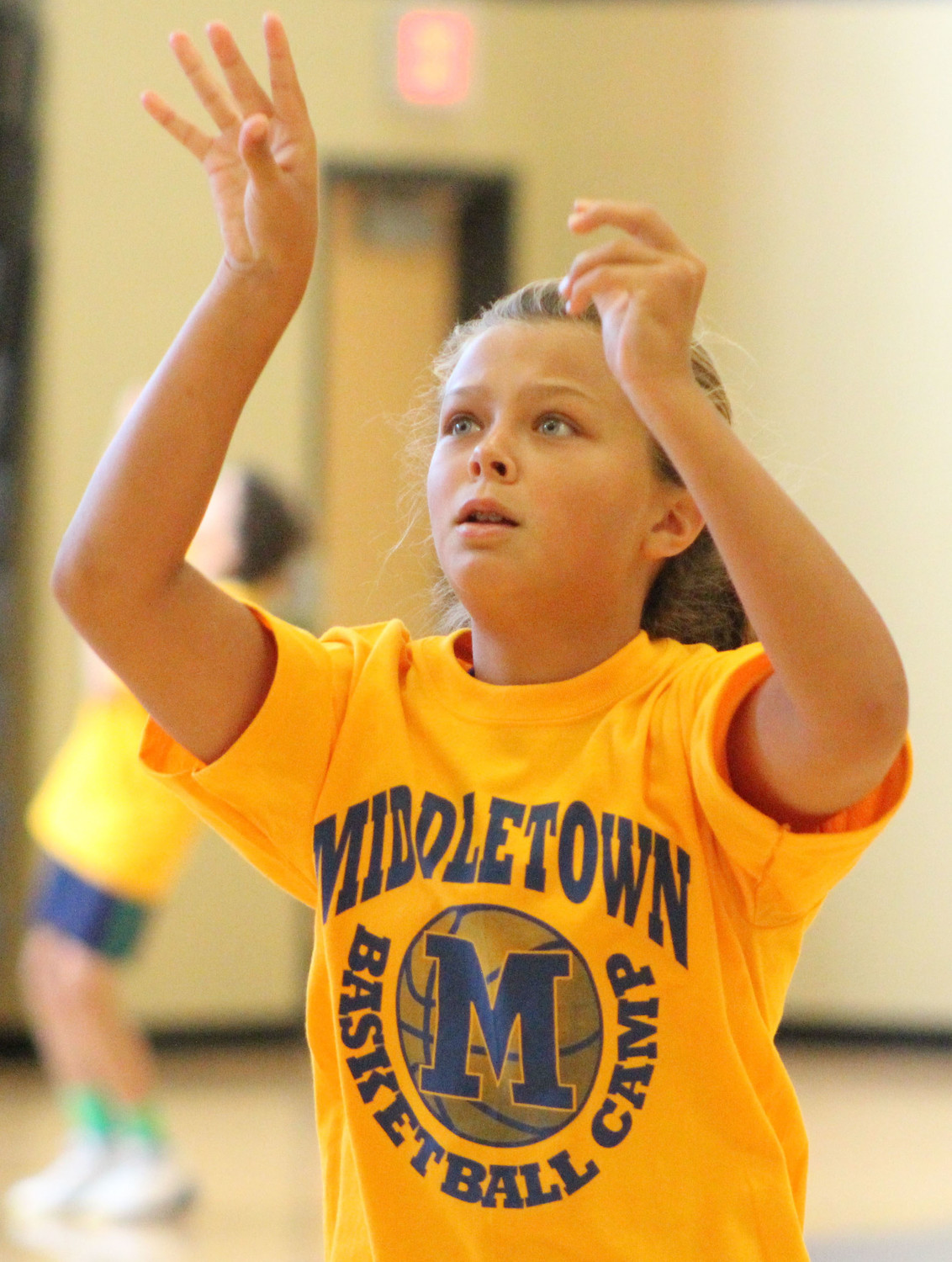 Addie Huber shoots the ball during basketball camp on July 12.