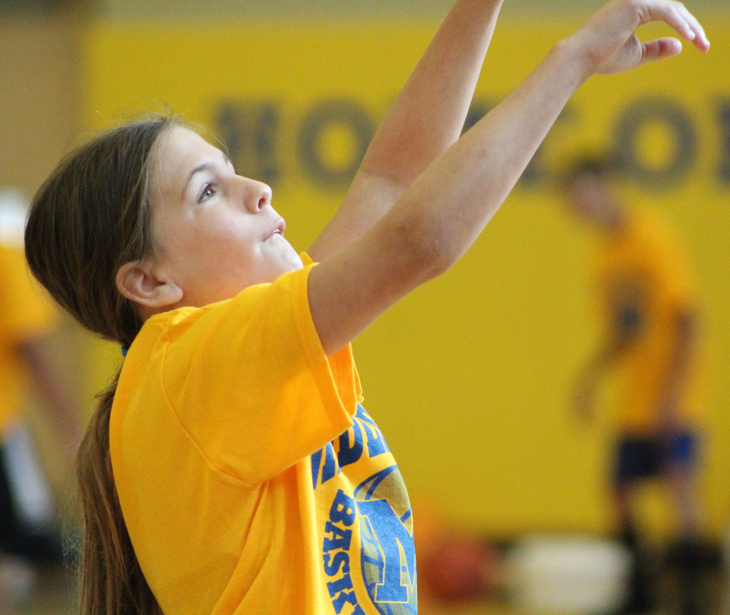 Brynlee Kephart shoots the ball during basketball camp on July 12.