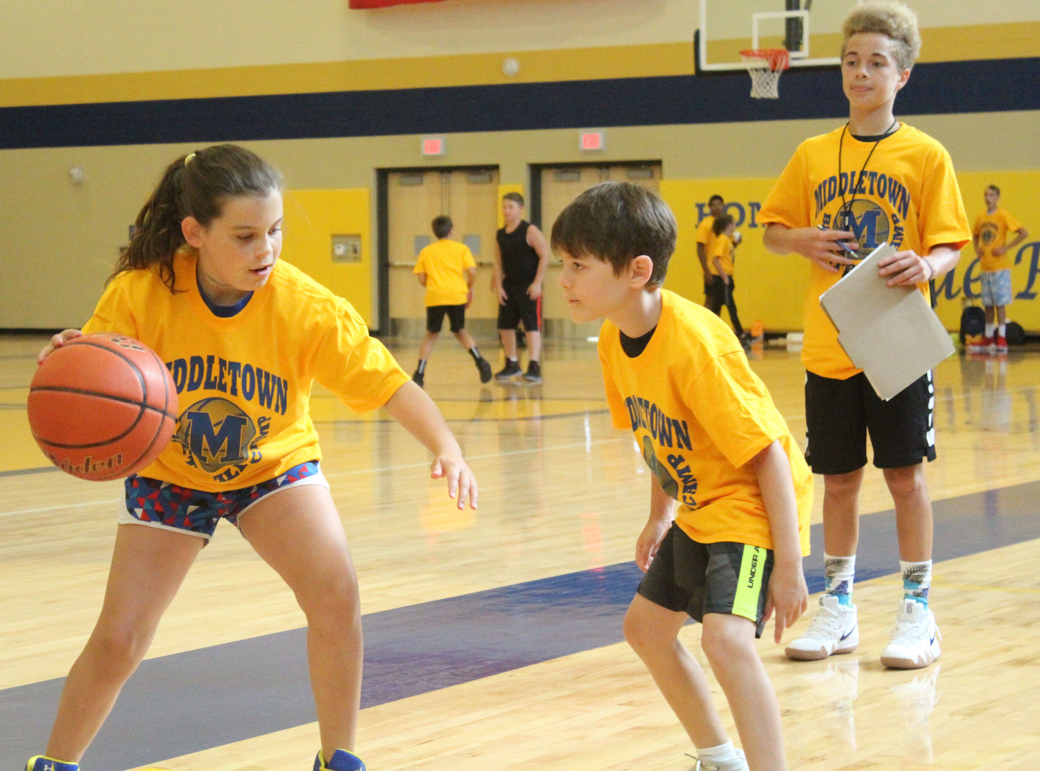 Hayden DeFilippo squares off against Brody Keating during basketball camp on July 12.