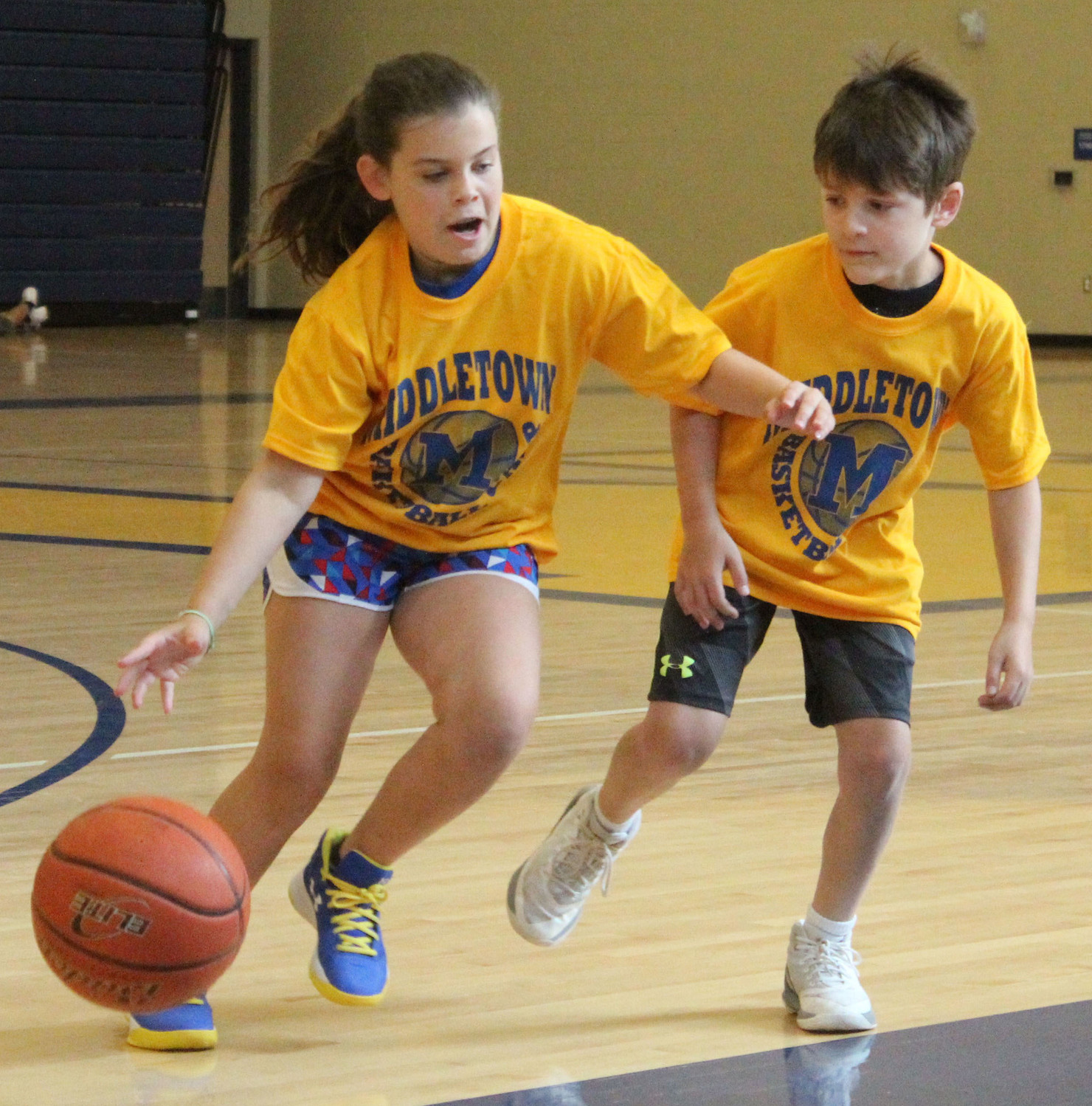 Hayden DeFilippo dribbles the ball during basketball camp on July 12.