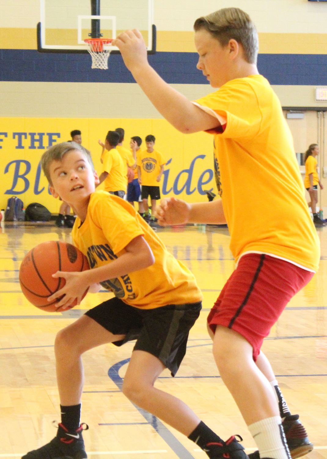 JP Horetsky blocks Parker Rios during basketball camp on July 12.