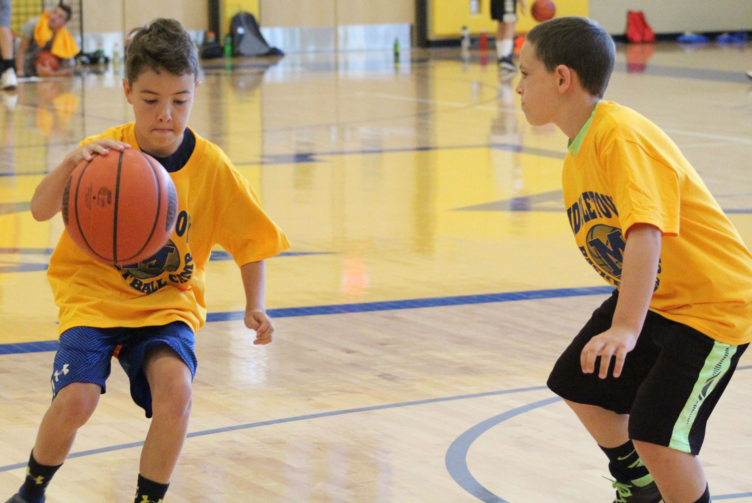 Cian Solliday makes a break against Josh Stains during basketball camp on July 12.