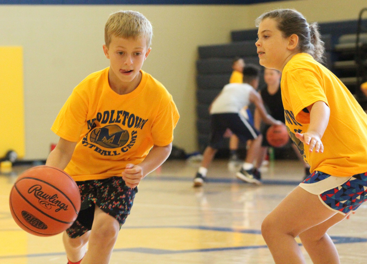 Lucas Myers dribbles the ball during basketball camp on July 12.
