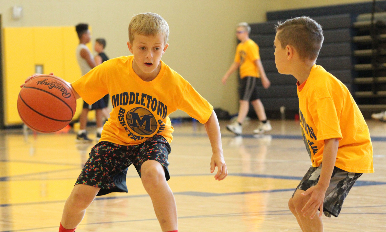 Lucas Myers faces off against Bryce DeFilippo during basketball camp on July 12.
