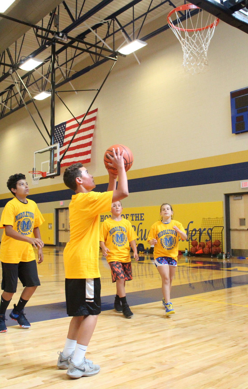 Tyson Leach shoots the ball the during basketball camp on July 12.